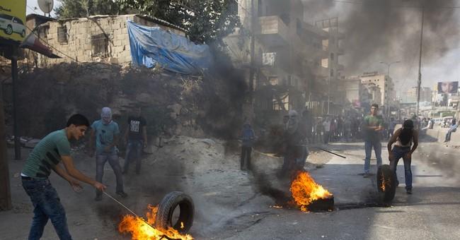The Latest: Israeli police say Palestinian stabs Israeli man