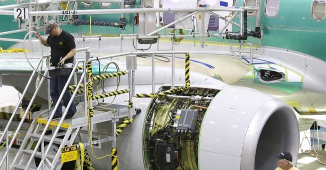 Boeing reports 4Q profit of $1.47 billion on airplane sales