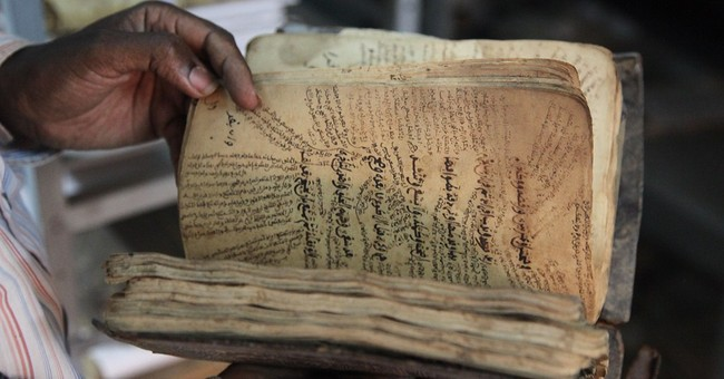 Saved Mali manuscripts face damage in new home