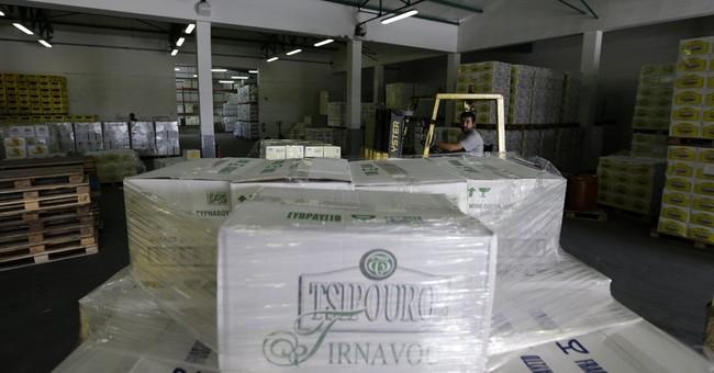 Tax hike on humble Greek drink threatens town's future