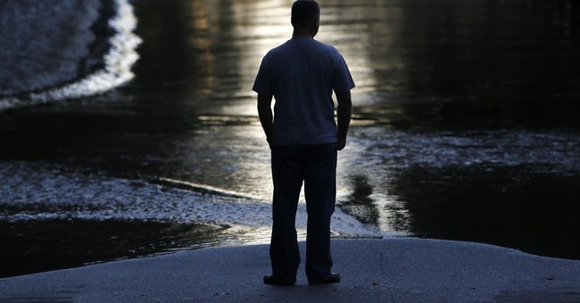 South Carolina still on edge from flooding; 2 people missing