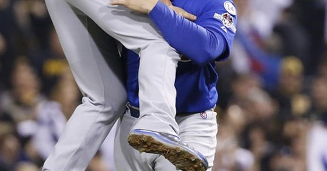 Arrieta, Cubs silence Pirates 4-0 to win NL wild-card game