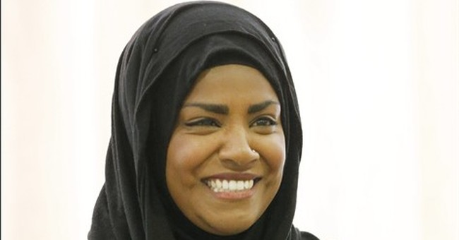 Britain takes star baker in a headscarf to its heart