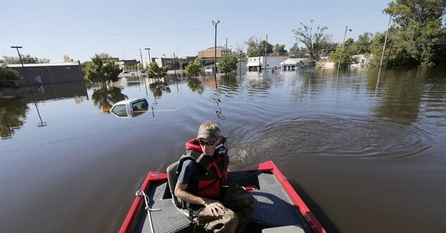 The Latest: National Guard asks residents to heed warnings