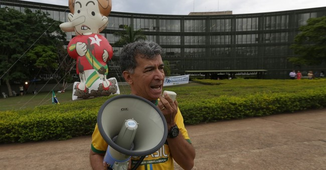 Analysts: Court ruling fuels bid to impeach Brazil president