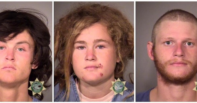 3 charged with killing tourist, hiker arrive in California