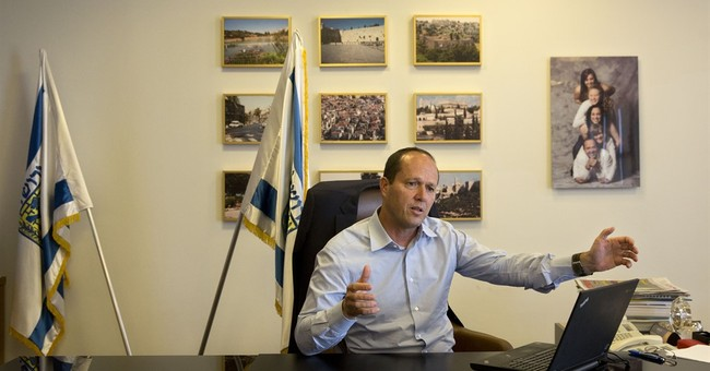 AP Interview: Jerusalem mayor defends gun display