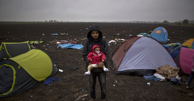 AP Photos: Portraits of refugees along Europe migrant trail