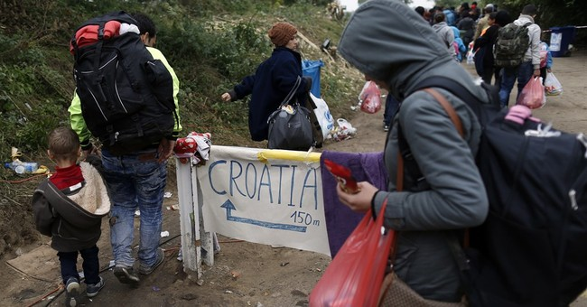 The Latest: German county declares refugee emergency