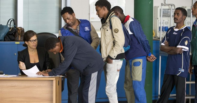 Italy sends 19 Eritreans to Sweden under new EU refugee plan