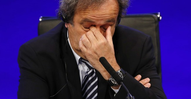 Platini retains UEFA title, with no interim leader in place
