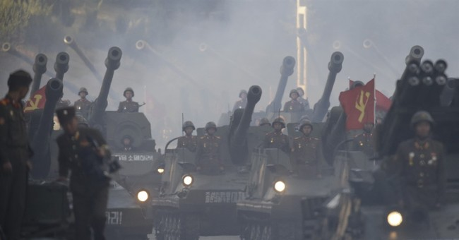 The Latest: North Korea shows off missiles, drones in parade