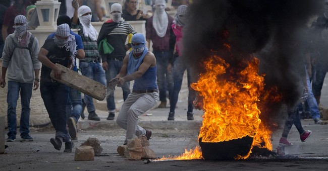 The Latest: Dozens briefly enter Israel from Gaza