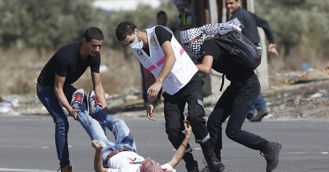 The Latest: Arab shot dead after stabbing Israeli soldier
