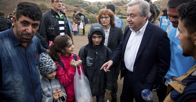 The Latest: UN official says migrants need new legal options