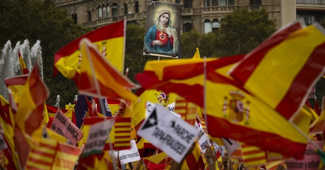 King Felipe presides at parade marking Spain's national day