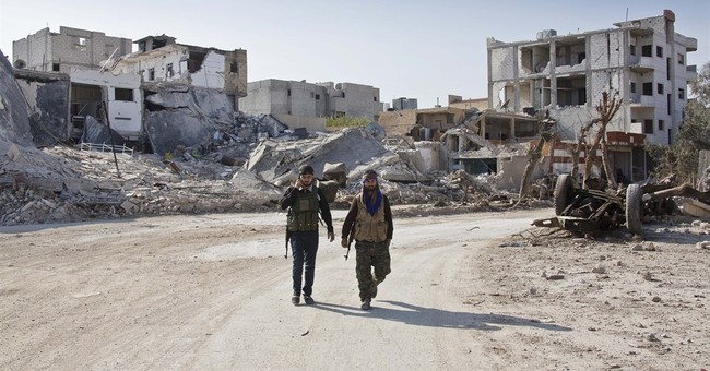 Rights group says US-backed Kurds displacing Arabs in Syria