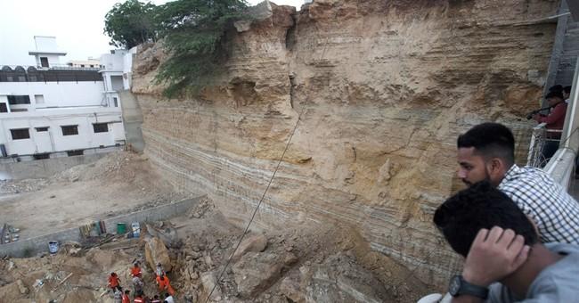Landslide hits makeshift homes in Pakistan, killing 13