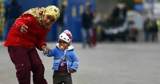 The Latest: Czech watchdog condemns asylum conditions