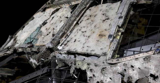The Latest: Ex-war crimes judge: Dutch report refutes Russia