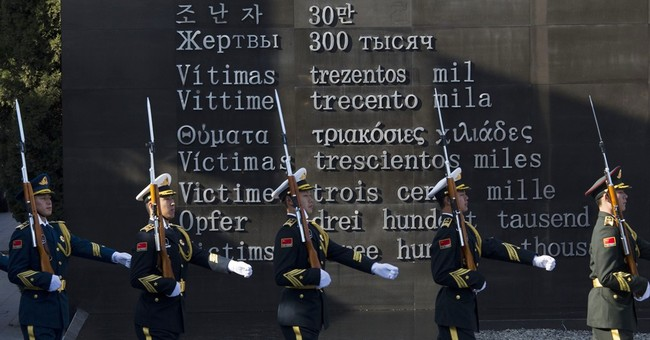 Japan says may cut UNESCO funds over Nanjing massacre move