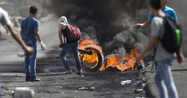 The Latest: Palestinians leader blames Israel for violence