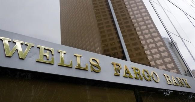 Wells Fargo's earnings edge up 1 percent to $5.4 billion