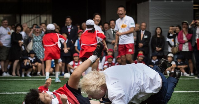 Basher Boris: London mayor topples 10-year-old in rugby game
