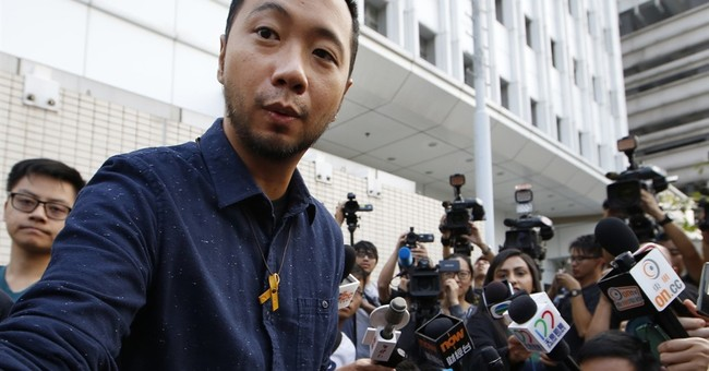 7 Hong Kong police charged over protester's filmed beating