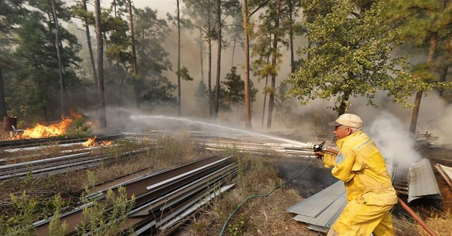 The Latest: Almost 3 dozen homes burned in Texas wildfire