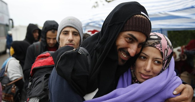 A balloon dog, a warm blanket: Aid eases refugees' misery