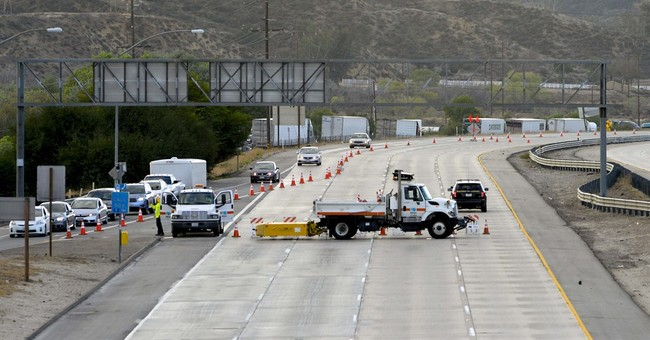 Roads reopen, most stuck vehicles freed from California mud