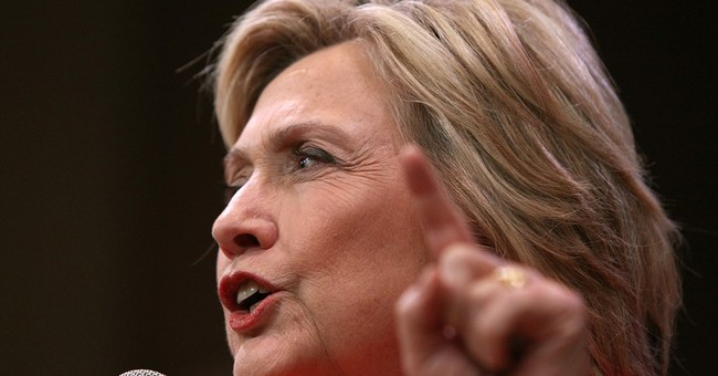 Clinton backs Obama's move to keep US forces in Afghanistan