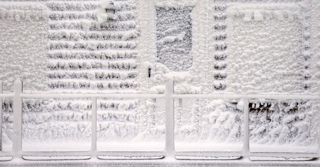 As Boston digs out, kids rejoice and drivers stake claims