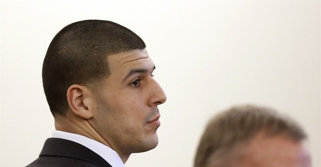 Ex-NFL star Aaron Hernandez goes on trial on murder charges