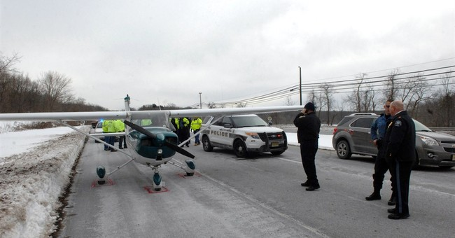 Small aircraft lands on New Jersey highway; no injuries