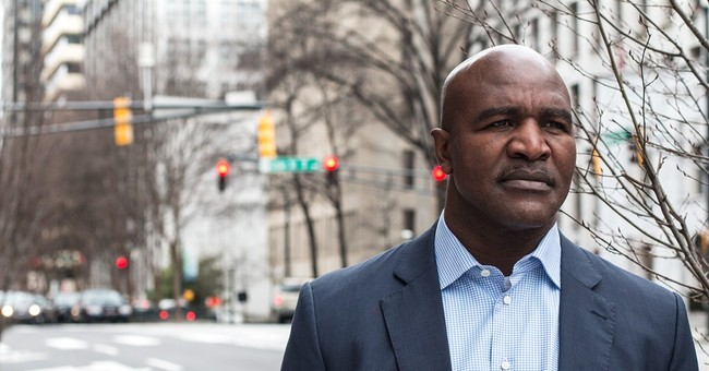 Stone-faced Holyfield has starring role in road rage PSA