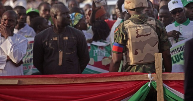 Angry youths stone Nigerian leader's convoy; police fire gas
