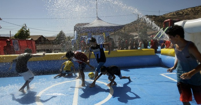 AP PHOTOS:  Chilean kids cool off during summer heat wave