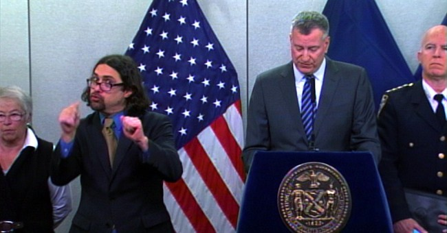 NYC mayor's vibrant deaf interpreter creates his own storm
