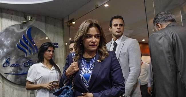 AP PHOTOS: Egyptian women candidates work the campaign trail