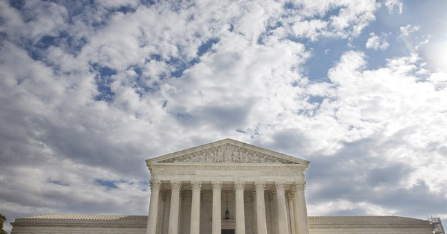 Justices mull appeal of Chicago suburb's assault weapons ban