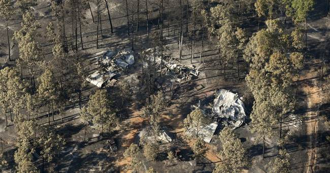Some Texas residents return to homes in fire-ravaged area