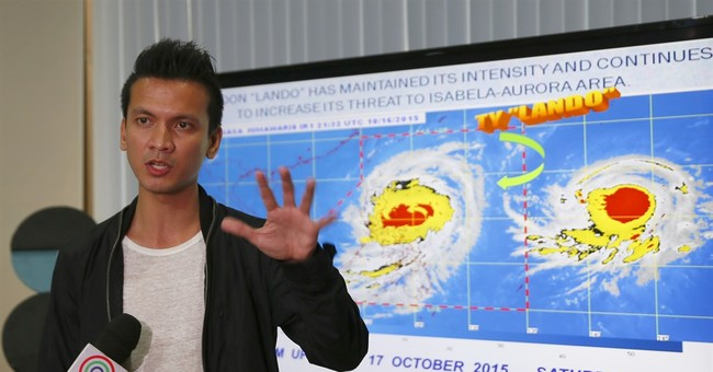 Slow-moving Typhoon Koppu slams into northern Philippines