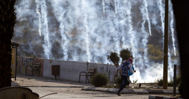 The Latest: Israel: Palestinian stabs policeman at crossing