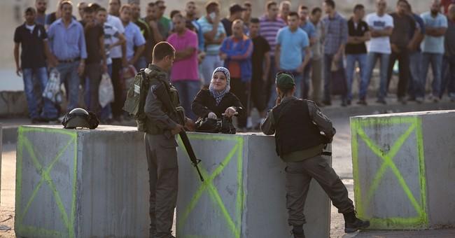 The Latest: Israeli police mistakenly shoot foreigner