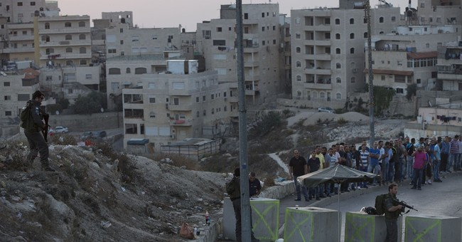 The Latest: Israeli army: 2 Palestinians killed after attack