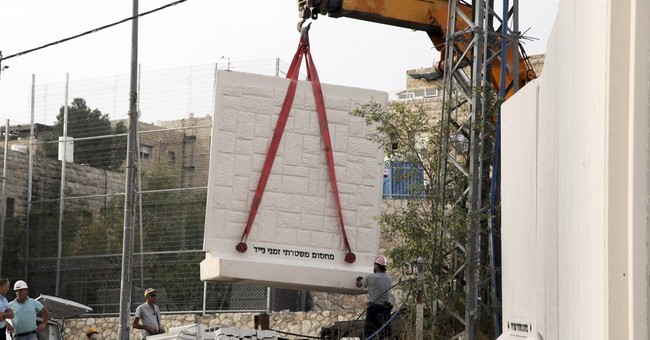 Israel: Assailant opens fire on bus station, soldier killed