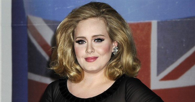 Adele appears to tease music fans with new material in TV ad