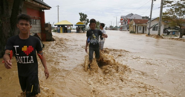 Typhoon leaves 11 dead, Filipino villagers saved from flood